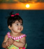 Baby. Sitting front of a sunset Stock Photos