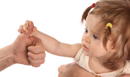 Baby. A baby holds on to the finger of hand Royalty Free Stock Photos