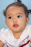 Baby. Close-up of a adorable little infant girl Royalty Free Stock Photos