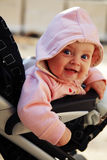 Baby of 6 months in the stroller Royalty Free Stock Photo
