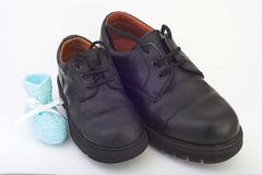 Baby, 7, 14 years old. Shoes of baby, 7, 14 years old boys stock photo