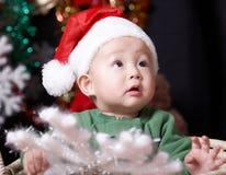 Baby. A cute baby boy in santa clothing at christmas eve Royalty Free Stock Photos