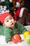Baby. And  fruits at holiday s eve Royalty Free Stock Photo