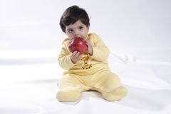 Baby. Eating apple Royalty Free Stock Photo