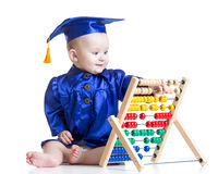 Baby with abacus toy. Concept of early learning Royalty Free Stock Images