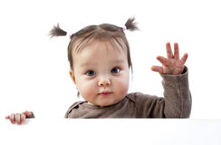 Baby above banner waving hand Royalty Free Stock Image