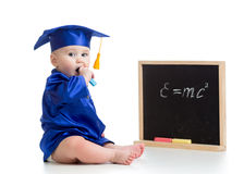 Baby academic with chalk at blackboard Stock Photography