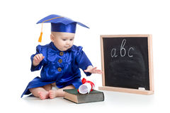 Baby in academician clothes with book at  blackboard Stock Image