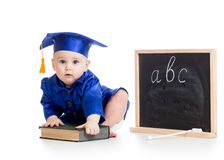 Baby in academician clothes with book Stock Photography