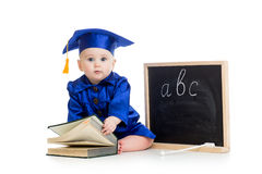 Baby in academician clothes with book and chalkboard. Baby girl in academician clothes with book and chalkboard royalty free stock photo