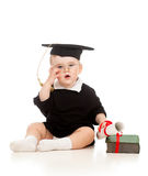 Baby in academician clothes  with roll and book. Baby in academician clothes  with book Stock Images
