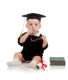 Baby in academician clothes  with roll and book. Baby in academician clothes  with roll,  book and glasses in hands Stock Photography