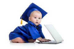 Baby in academician clothes using laptop Royalty Free Stock Photography