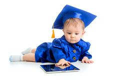 Baby in academician clothes using tablet PC. Funny baby in academician clothes using tablet PC stock photos