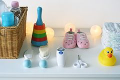 Baby accesories and stuff. Baby accesories and goods on the white chest of drawer Stock Images