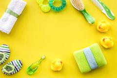 Baby accessories for bath with body cosmetic and ducks on yellow Royalty Free Stock Photo