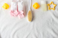 Baby accessories for bathing on towel, flat lay royalty free stock photography
