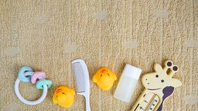 Baby accessories for bathing and toy on towel with copy space, flat lay royalty free stock photo