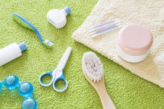 Baby accessories for bathroom. On the green towel Royalty Free Stock Photography