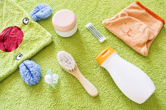 Baby accessories for bathroom. On the green towel Stock Photo