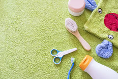 Baby accessories for bathroom. On green towel Royalty Free Stock Photos