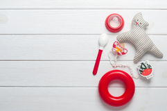 Baby accessories over white wooden background Royalty Free Stock Photo