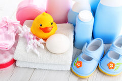 Baby accessories. On white wood - children royalty free stock photo