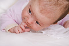 Baby action..:). Two months old baby girl struggling to keep up her head stock images