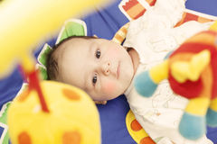 Baby on activity mat. Playing royalty free stock photography