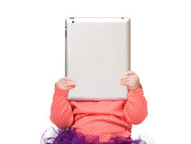 Baby addict to digital tablet Stock Images