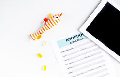 Baby adopting concept with application and tablet top view mock up