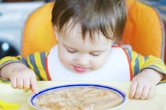 Baby age of 16 months eating Royalty Free Stock Images