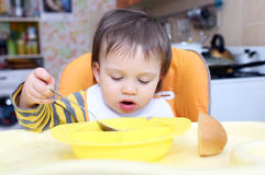 Baby age of 16 months eating soup Royalty Free Stock Image