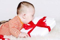 Baby age of 5 months with gift Stock Images