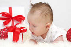 Baby age of 3 months with gift Royalty Free Stock Photo