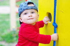 Baby age of 10 months on playground in summer Stock Photos