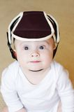 Baby age of 8 months in safety helmet Royalty Free Stock Image