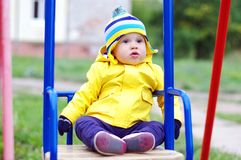 Baby age of 11 months on seesaw royalty free stock images