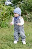 Baby age of 11 months walking in park Stock Image