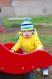 Baby age of 1 on playground Stock Photos