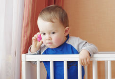 Baby age of 1 year calling toy mobile telephone Royalty Free Stock Images