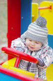 Baby age 1 year driving car on playground Stock Images