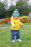 Baby age of 1 year walking in park Royalty Free Stock Photos