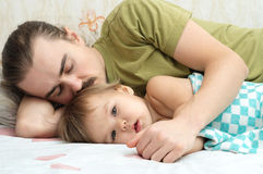 Baby ailing with daddy Stock Photos