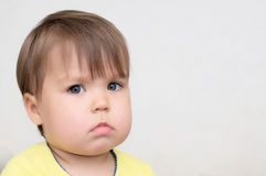 Baby alerted watching at you. Caucasian little baby alerted watching at you Stock Image