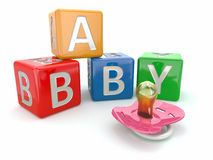 Baby from alphabetical blocks and dummy Royalty Free Stock Photo