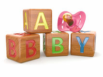 Baby from alphabetical blocks and dummy Stock Images