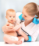Baby And Doctor Pediatrician. Doctor Listens To The Heart With S Stock Photos