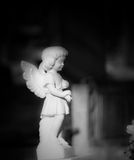 Baby Angel. Weathered marble Graveyard Monument of a young angel Royalty Free Stock Photos