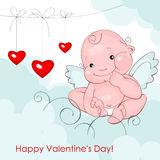 Baby angel with three hearts Stock Photo